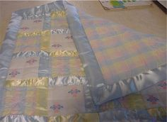 Love this machine embroidered quilt with lots of satin binding! My babies loved satin!