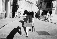 #summer #rain #sun #hot #umbrella #walking #filmisnotdead #film #siena #shadow #light #rpx #100 #leica #street #photography