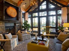HGTV Dream Home - steel, windows and wood. Yellow wing back chair.
