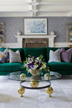 Owned by a young family, this living room from Jenn Feldman Designs evokes a sense of luxury while also remaining durable to withstand the attentions of young children. The bold, rich tones were inspired by the family's extensive art collection.
