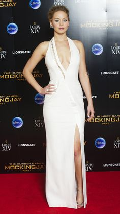 Jennifer Lawrence attends the after party for the 'The Hunger Games: Mockingjay Part 1' in another stunning white gown. via @stylelist | http://aol.it/1uZDDwO