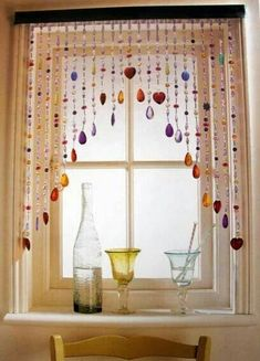 Cool idea for a smaller window and with glass or wooden beads instead of cheesy plastic ones.