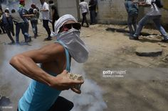 A demonstrator clashes with the police during a rally against Venezuelan President Nicolas Maduro, in Caracas on April 19, 2017. Clashes broke out Wednesday at massive protests against Maduro, as riot police fired tear gas to push back stone-throwing demonstrators and a young protester was shot dead. Violence erupted when thousands of opposition protesters tried to march on central Caracas, a pro-government bastion where red-clad Maduro supporters were massing for a counter-demonstration…