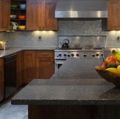 Engineered Stone. Better than granite. Resists stains better, doesn't need sealing and eco-friendly.