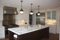 Calcutta marble.     renovation contemporary-kitchen