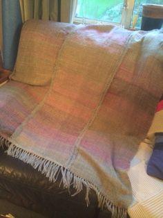 Finished three panel blanket. Double knitting weight grey warp; random colour sock yarn weft.