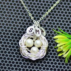 Silver with silver leaves  Etsy listing at https://www.etsy.com/listing/116262823/three-initial-bird-nest-necklace
