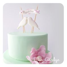 Engagement cake with birds and flower (sugar magnolia)