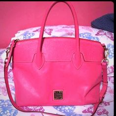 Authentic Dooney and Bourke Good condition as you can see in the picture.medium size.Come from smoke free and pet free home.Color pink with crossbody straps on it.great bag for everyday bag. Dooney & Bourke Bags Shoulder Bags