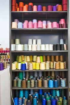 A cabinet of colorful threads shows a sneak peek of Rachel Roy's current favored color palettes.    Photographed by Sam Horine