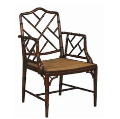 Charlotte and Ivy loves our gorgeous best-selling Chinese Chippendale arm chair! You'll love the exceptional faux bamboo legs, fretwork back, and a beautiful caned seat . Chinese Chippendale chairs work well with modern and traditional homes. These truly classic chairs date back to the 18th century Regency styles but mesh with modern, rustic and glamorous homes.