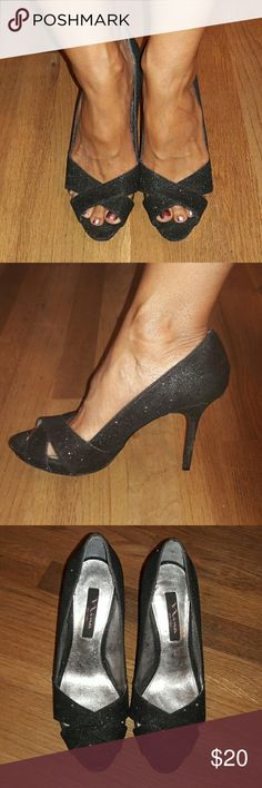 """NINA glittery peep toe pumps The PERFECT evening shoe for ypur little black dress! Shimmery black fabric uppers with a criss-cross vamp. Slight .5"""" platform and a 4"""" heel. In exellent used condition! Nina Shoes Heels"""