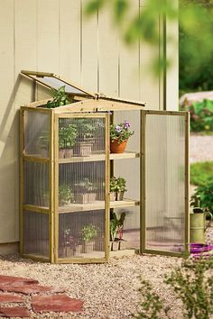 Patio Grow House-- this isn't made for outside /rain use, but the design/shape is what I would like for a cold frame. Home Greenhouse, Greenhouse Gardening, Greenhouse Ideas, Outdoor Greenhouse, Homemade Greenhouse, Greenhouse Wedding, Cheap Greenhouse, Diy Small Greenhouse, Container Gardening