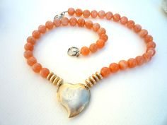Peach Moonstone semiprecious stones and Sterling Silver focal heart necklace. Wire Wrapped Jewelry, Wire Jewelry, Gemstone Necklace, Beaded Necklace, Peach Moonstone, Short Necklace, Turquoise Earrings, Beautiful Necklaces, Natural Gemstones