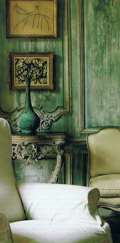 Greens — walls, chairs, side table, vase