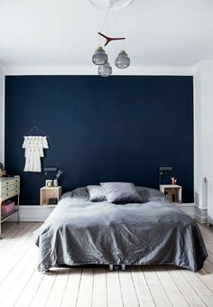 Nordic bedroom with a dark blue colored end wall and grey pillows and bedspread…. Nordic bedroom with a dark blue colored end wall and grey pillows and bedspread. Dark Blue Bedrooms, Blue Gray Bedroom, Bedroom Colors, Nordic Bedroom, Home Decor Bedroom, Modern Bedroom, Bedroom Ideas, Bedroom Décor, Contemporary Bedroom