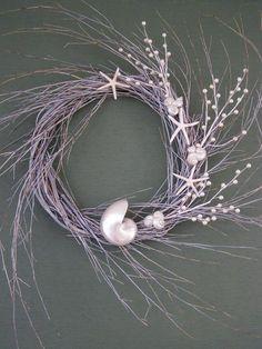 CHRISTMAS BEACH DECOR, seashell wreath, pearlized nautilus, pearls. driftwood toned. $58.00, via Etsy.