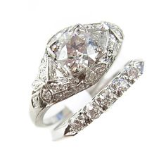 This is a wedding set but when I first saw it, I thought it was an open snake ring with a marquis diamond in the head.