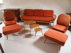 Ercol 3 piece suite, pebble coffee tables and footstools . So wish I had room for them Ercol Furniture, Outdoor Furniture Sets, Mid Century Living Room, Clever Design, Coffee Tables, Living Area, 3 Piece, Woodworking Projects, Accent Chairs