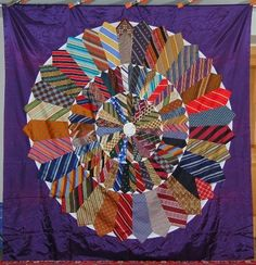Fan Wheel or Wheel of Fortune quilt made with neckties - circa 1950