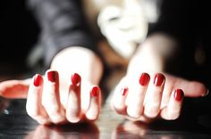 Perfectly painted red nails are one of the best accessories.