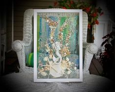This Sea Glass Art is a beautiful piece that is ready to great to hang on a wall or a window! Any beach lover would treasure this piece forever.  The shells are bonded onto the glass with resin. The simple classic frame measures approximately 12 x 18, and is pure white in color.  Among the Mermaid Wall Decor, Mermaid Bathroom, Bathroom Art, Mermaid Art, Blue Wall Decor, Heart Wall Art, Coastal Wall Art, Sea Glass Art, Window Art