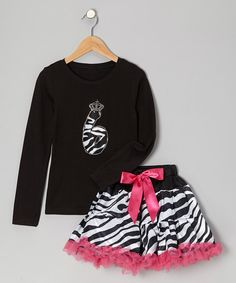 Designed to proudly display a glamour girl's age, this party-perfect ensemble is ready for a full day of celebration. The stretchy tee shows off a sparkly zebra print design, and the poufy pettiskirt has a smooth, covered elastic waistband.Includes tee and pettiskirtPolyester / cottonMachine wash; tumble dryImported