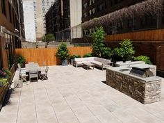 Rooftop garden in NYC with porcelain pavers and outdoor kitchen. Rooftop Garden, Backyard, Patio, Design Projects, Landscape Design, Porcelain, Nyc, Outdoor Decor, Kitchen