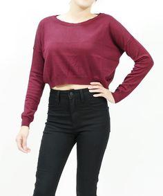 Long sleeve boxy knit crop sweater.