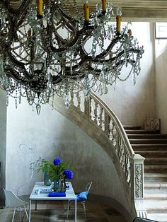 huge chandelier, sweeping stairs all touched by blue Interior Architecture, Interior And Exterior, Interior Design, Chandeliers, Tricia Guild, Raindrops And Roses, Old Room, World Of Interiors, Stairway To Heaven
