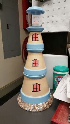 Clay pot lighthouse. Camping Crafts For Kids, Kids Camp, Clay Pot Lighthouse, Clay Pot People, Clay Pot Crafts, Painted Pots, Light House, Terracotta Pots, Clay Pots