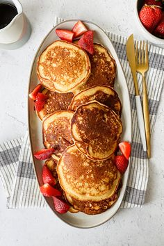 These wholesome and delicious pancakes are stuffed with tons of fresh strawberries! Recipe by Something Nutritious. #californiastrawberries #strawberrypancakes #yogurtpancakes #oatflourpancakes #glutenfreepancakes #brunchrecipes #breakfastrecipes #strawberrybreakfast