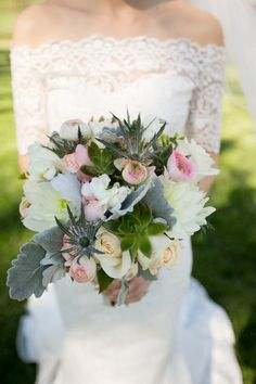 Soft-hued wedding bouquet of roses, dahlias, ranunculuses, thistle, dusty miller, freesia, and succulents {Lovesome Photography}