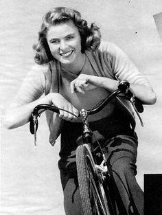 Ingrid Bergman riding a bike