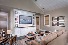 Shelves on the side if the space is too large. Beach Style Family Room by GRADY-O-GRADY Construction & Development, Inc.