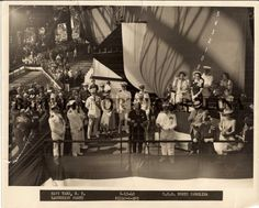 Black and white photograph of BB-55 launching party just before christening, June 13, 1940. Governor Hoey is delivering speech at microphones. Isabel Hoey on platform, far right, near ship's bow.