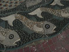 Mosaic fishes, part of a huge pebble mosaic in Bournemouth Square by Maggy Howarth