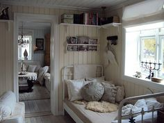 Norwegian style decorating | Norwegian design- Like shelves up high like they are over this bed