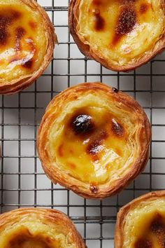Pastel de Nata - A crisp pastry shell houses creamy custard before baking until golden for this beloved Portuguese egg tart recipe from George Mendes. No plane ticket required. Portuguese Egg Tart, Portuguese Desserts, Portuguese Recipes, Portugese Custard Tarts, Portuguese Custard Tart Recipe, Tart Recipes, Baking Recipes, Sweet Recipes, Dessert Recipes