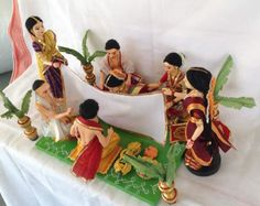 Here is set of dolls where marriage ceremony functions are going on.There is a sweet couple. You can use this set of dolls during marriage occasions. Or to gift this set of dolls at someone marriage occasions. Indian Wedding Gifts, Wedding Gifts For Guests, Indian Wedding Decorations, Wedding Doll, Wedding Art, Barbie Decorations, Thali Decoration Ideas, Barbie Doll Set, Homemade Dolls
