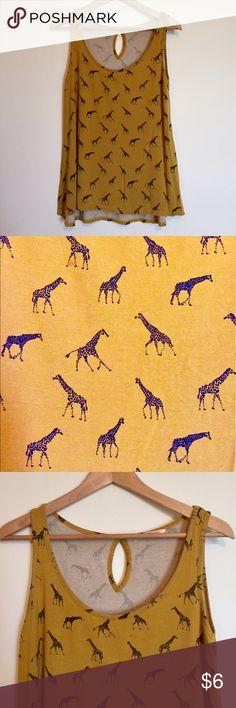 "Giraffe print tank top Cute giraffe print tank. Loose, tent like fit. Key hole back. Purchased in France, brand is Camaieu. Length: 25"", bust: 18"". Tops Tank Tops"