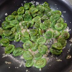 sauteed fiddlehead ferns with garlic, lemon juice, pepper, and sea salt is how I cook it
