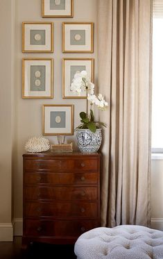 www.yournestdesign.blogspot.com Take advantage of a narrow space to go vertical. The frames lead the eye up... the accessories on the chest are simple but beautiful in their own right.