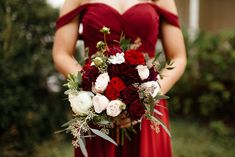 We love a deep burgundy bouquet with pops of red and creams to brighten this whole look up. Photo Credit to The Hatches Photography.