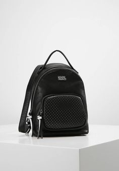"""KARL LAGERFELD. SUPER - Rucksack - black. Fastening:Zip. length:6.5 """" (Size One Size). width:4.0 """" (Size One Size). Lining:textile. carrying handle:2.0 """" (Size One Size). Outer material:leather. height:9.0 """" (Size One Size)"""