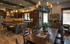 Open Floor Plan Dining & Kitchen. Stunning Rustic Southwestern Flair home located in Bridger Canyon, Bozeman, Montana. Designed by Formescent Architects, built by Parks Angel Construction, photos by Jeremy Thurston Photography. #formescent #bozemanarchitecture