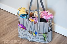 A free pool bag sewing tutorial. A free sewing pattern for a cute large pool bag with lots of outer pockets.