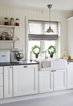 Topiaries, shade, vintage inspired kitchen