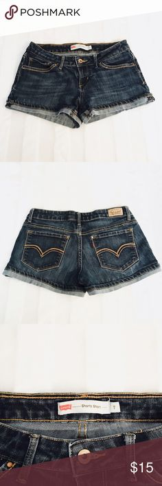Levi's shorty short cuffed jean shorts size 7 Levi's Low Rise 'Shorty Short' Medium Wash With Cuffed Bottoms Juniors Size 7  Length: 10in  Inseam: 3in  Waist flat across: 15in Levi's Shorts Jean Shorts
