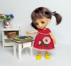 Raspberry crocheted dress for 3.5 inch doll decorated
